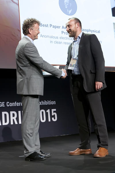 Receiving the Loránd Eötvös award from Philip Ringrose, President EAGE.
