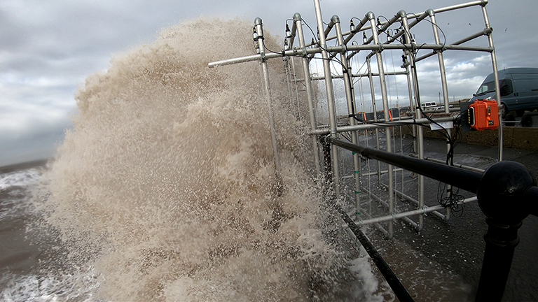 Wave overtopping and WireWall in action at Crosby Beach, January 2019