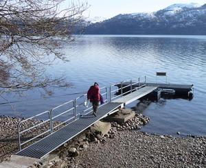 David Pugh about to install a pressure sensor under a floating pier on the north shore of Loch Ness