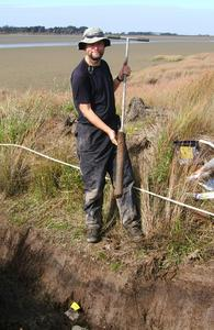 Extracting cores from a marsh in southern New Zealand (courtesy: Prof Gehrels)