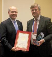Geraint West receives the 'International Maritime Partner' award on behalf of NOC