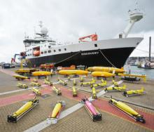 RRS Discovery with some of NOC's autonomous vehicles in the foreground