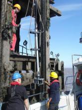 Engineers carrying out tide gauge repairs