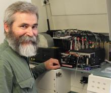 Professor Mikhail Zubkov beside the human blood counting machine