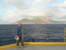 Martin Palmer with volcano in background