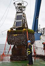 Adrian Bunting, MetO, with the barnacle-encrusted PAP 1 ODAS buoy
