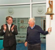 Prof Walter Munk rings the bell from RRS Charles Darwin