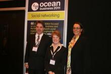 Prof. Edward Hill (NOC, left), Dr Wendy Watson Wright (IOC), and Versha Carter (Intelligent Exhibitions Ltd)