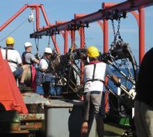 Geophysical equipment ('airguns') being deployed