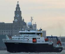 RRS Discovery passing the Liver Building, Liverpool