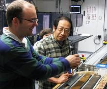Co-chief Scientists Heiko Pälike, NOC and Hiroshi Nishi (Co-chief Scientist, Hokkaido University, Japan) in the Core Lab (© IODP)