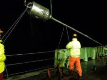 Gravity core being deployed at night off South Georgia