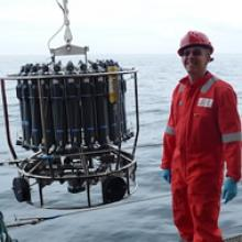 Doug Connelly deploying the *conductivity, temperature, depth (CTD) package into a calm Bransfield Strait