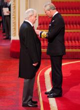 Phil Woodworth receiving his MBE (British Ceremonial Arts Ltd)